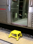 Yellow step stool to help passengers off train